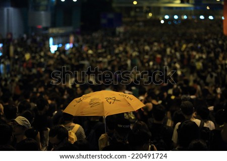 """HONG KONG, SEPT.29: protester holding the umbrella which the word mean"""" change"""" on it in Admiralty on 29 Sept 2014. umbrella become the sign after riot police fire tear shell in peaceful rally - stock photo"""