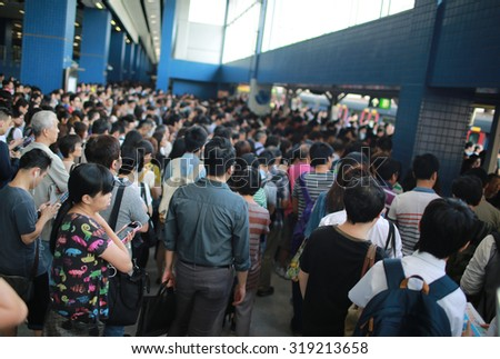 HONG KONG,SEPT 22: the crowd in Train station are waiting as the delaying train in hong kong on 22 September 2015. MTR was hit by service disruption on three lines in just one day in 22 sept. - stock photo