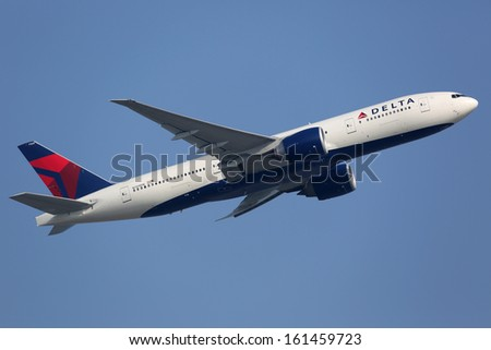 HONG KONG - SEPTEMBER 26: A Delta Boeing 777 takes off on September 26, 2013 in Hong Kong. Delta Air Lines is the world's largest airline with 733 planes and 160 million passengers in 2012.