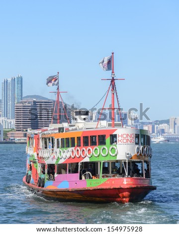 "HONG KONG - SEPTEMBER 20: Ferry ""Day Star"" arriving Kowloon pier on September 20, 2013 in Hong Kong, China. Hong Kong ferry is in operation for more than 120 years and is one main tourist attractions. - stock photo"