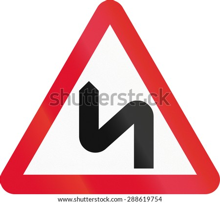 Hong Kong sign warning about a double curve first to left. - stock photo