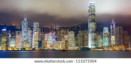 Hong Kong skyline at mist over Victoria harbor - stock photo