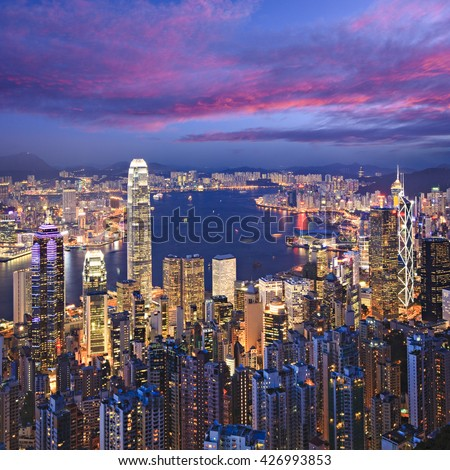 Hong Kong skyline illuminated at twilight, square format.