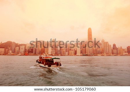 Hong Kong skyline in the morning over Victoria Harbour in red tone. - stock photo