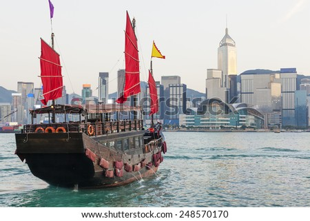 Hong Kong skylines and junk boat in the daytime - stock photo