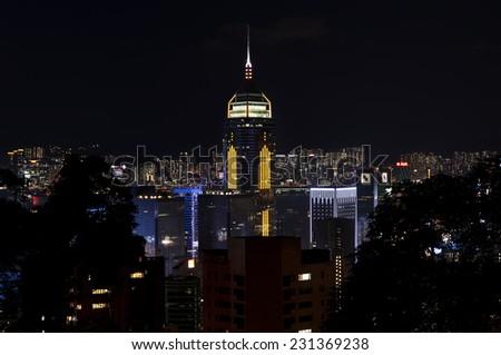 Hong Kong Skyscraper Central Plaza illuminated at night, Hong Kong Island - stock photo