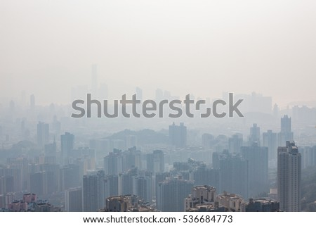 Hong kong tall buildings in haze at day