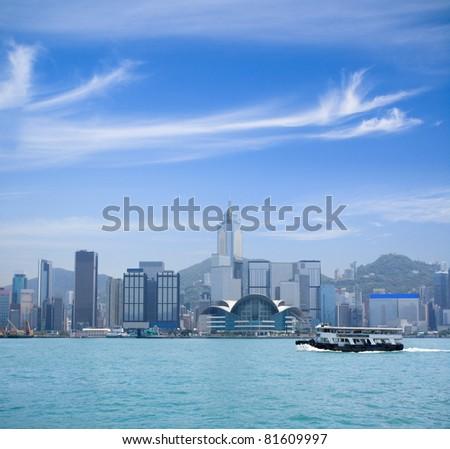 hong kong victoria harbor against a blue sky - stock photo