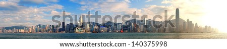 Hong Kong Victoria Harbor in afternoon with urban city skyline and colorful cloud - stock photo
