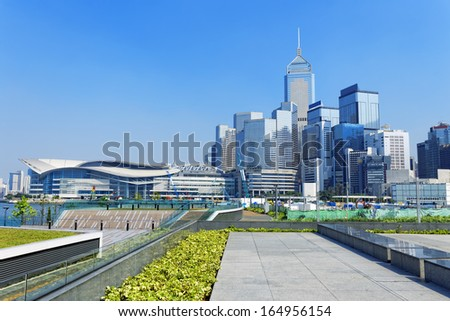 Hong Kong Victoria Harbor morning with urban skyscrapers over sea with blue sky - stock photo