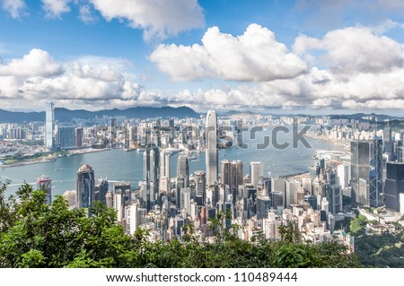 Hong Kong Victoria Harbor with blue sky - stock photo