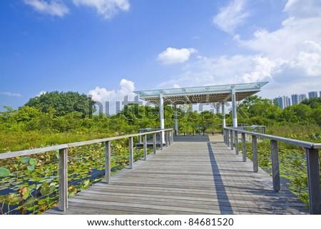 Hong Kong Wetland Park, with long walking path. - stock photo