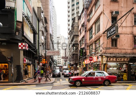 HONGKONG , CHINA-JULY 7 : Lifestyles of Hong Kong popular walking and taxi service. Because space is limited, so the city seemed more crowded dwellings. at Matheson Street on July 7,2014 in Hong Kong