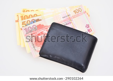 HongKong currency and wallet on white background