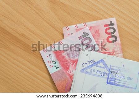 Hongkong passport stamps dollar bills - stock photo
