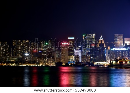 HONGKONG - SEPTEMBER 14: Night building colorful light beside Hongkong Victoria Harbor, on September 14, 2016 in Hongkong, China. Hongkong is a big international city in South of China.