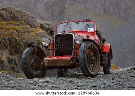 HONISTER PASS, ENGLAND - NOVEMBER 10:  A Singer sports car in The Honister Hill Climb in the English Lake District.  The Vintage Sports Car Club event took place in the rain on November 10, 2012.