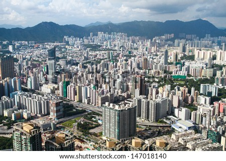HONK KONG � JULY 14: Aerial view of Hong Kong city on July 14, 2013. Hong Kong is one of the world's leading international financial centers and has a major capitalist service economy. - stock photo
