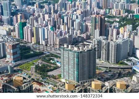 HONK KONG � JULY 14: Ariel view of Hong Kong city on July 17, 2013. Hong Kong is one of the world's leading international financial centers and has a major capitalist service economy. - stock photo