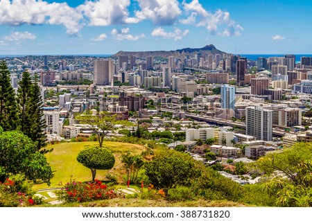 Honolulu and Diamond Head Crater from the Punchbowl National Memorial Cemetery of the Pacific Cemetery in Oahu, Hawaii. - stock photo