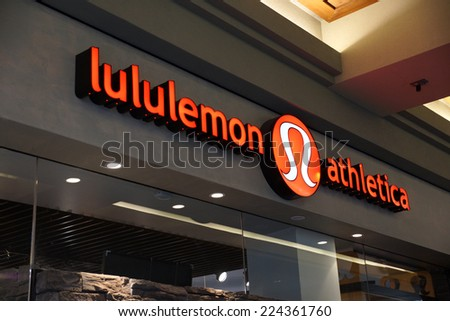 HONOLULU - AUGUST 7, 2014: Lululemon store exterior and sign at the Ala Moana Center has over 260 stores. on August 7, 2014. - stock photo