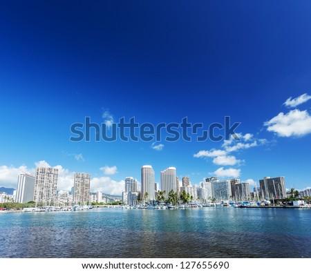 Honolulu cityscape with Waikiki yacht club and seafront - stock photo