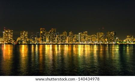 Honolulu cityscape with Waikiki yacht club and seafront at night - stock photo