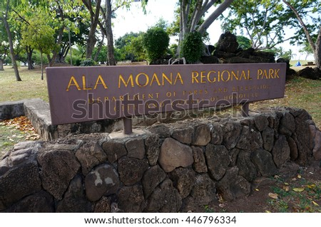 HONOLULU - FEBRUARY 21: Ala Moana Regional Park - Sign on top of lava rocks leading to park February 21, 2016 in Honolulu, Hawaii. 100-acre park has a wide gold-sand beach that is over half-mile long. - stock photo