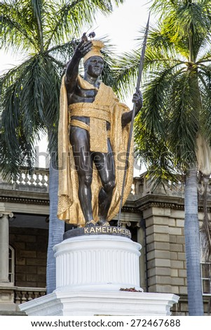 Honolulu, Hawaii - January 11, 2015: Famous statue of King Kamehameha  at the Aliiolani Hale Palace in downtown Honolulu, Hawaii. - stock photo