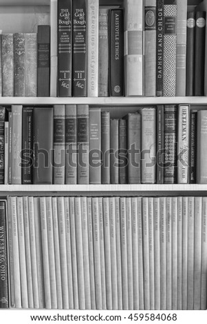 Honolulu, Hawaii, July 28, 2016:  Rare leather bound books on white shelves in black and white.