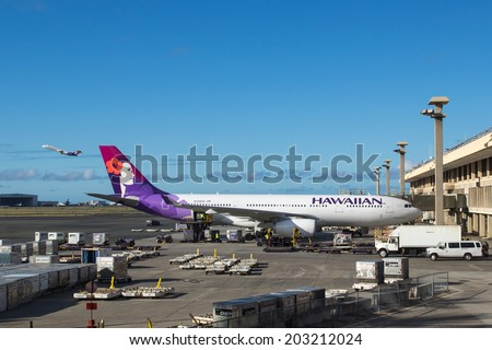 HONOLULU, HAWAII - JUNE 24 2014: Hawaiian Airlines planes on the ground and in the air at Honolulu International Airport in Hawaii - stock photo