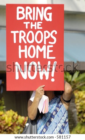 Honolulu, Hawaii - September 25, 2005 - Approximately 100 demonstrators take to the streets of Honolulu to protest the United States involvement in the war in Iraq. - stock photo