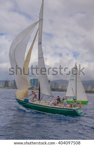Honolulu, Hawaii, USA, April 11, 2016:  Racing sailboat beginning the first race of the 2016 Season with a spinnaker sail flying.