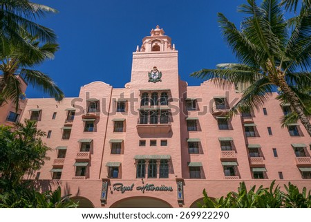 Honolulu, Hawaii, USA. April 16, 2015: The freshly repainted Royal Hawaiian Hotel is open for discriminating world travelers. The Royal has provided world class service in Waikiki for over a century.