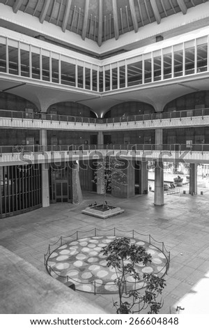Honolulu, Hawaii, USA, April 5, 2015:  The open courtyard of the Hawaii State Legislature  welcomes residents and visitors to the Hawaii State seat of government.   - stock photo