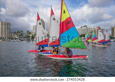 Honolulu, Hawaii, USA, April 30, 2015:  Women sailing competitors in the Hawaii State Sailing Championships held yearly in Waikiki.  Women Sailors are a rising force of top athletes in Hawaii. - stock photo