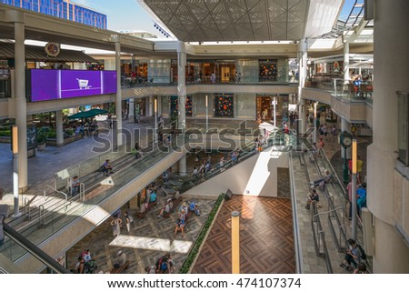 Honolulu, Hawaii, USA, August 26, 2016:  Afternoon view of the new three level  Ala Moana Shopping Center with bright sunlight in the background.