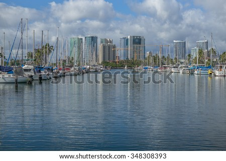 Honolulu, Hawaii, USA, Dec. 7, 2015:  Morning view of the Ala Wai Small Boat Harbor with downtown Honolulu in the background.  Winter colors and temperatures are much cooler from Summer conditions.
