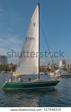 Honolulu, Hawaii, USA, Jan. 16, 2017:  Evening view of a Waikiki sailboat preparing to sail to Maui.