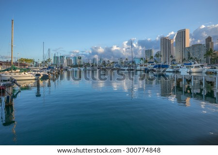 "Honolulu, Hawaii, USA, July 28, 2015:  ""Ala Wai Harbor""  Dawn view of the State of Hawaii Ala Wai Harbor as competing sailboats arrive after finishing in the 2015 Transpacific Yacht Race."