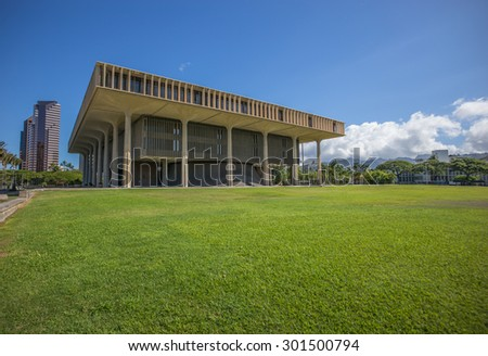 Honolulu, Hawaii, USA, July 30, 2015:  Morning view of the Great Lawn at the Hawaii State Legislature Building with the newly refurbished building in the background.