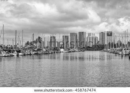 Honolulu, Hawaii, USA, July 26, 2016:  Panorama view of the Ala Wai Small Boat Harbor with the Ala MOana District in the background.