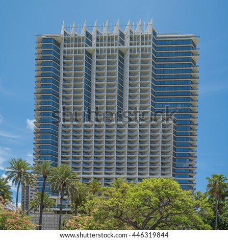 Honolulu, Hawaii, USA, July 2, 2016:  Park view of the new Trump Tower Waikiki with a blue sky background.