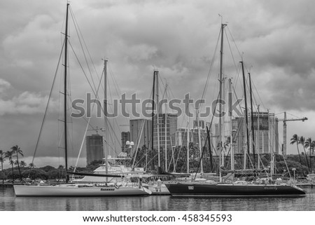 Honolulu, Hawaii, USA, July 26, 2016:  Two racing sailboats moored at the Waikiki Yacht Club after finishing the 2016 Pacific Cup Sailboat Race.