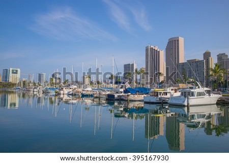 Honolulu, Hawaii, USA, March 23, 2016:  Morning view to the Ala Wai Harbor with Waikiki hotels in the background.