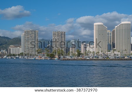 Honolulu, Hawaii, USA, March 7, 2016:  Offshore view of the channel entrance to he State of Hawaii Ala Wai Harbor in Waikiki.