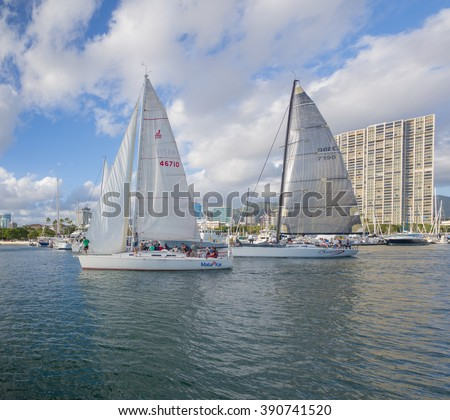 Honolulu, Hawaii, USA, March 14, 2016:  Two sailboats and their crews prepare for the start of a race from the Ala Wai Harbor to Waikiki.