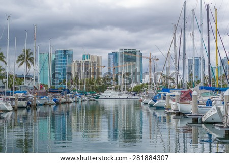 Honolulu, Hawaii, USA, May 27, 2015:  Afternoon clouds above the Ala Wai Small Boat Harbor in Honolulu.  The Ala Wai Harbor is hosting the 2015 Trans Pacific Yacht Race.