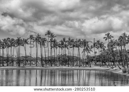 Honolulu, Hawaii, USA, May 22, 2015:  Ala Moana Beach Park has opened a recreational lagoon for water sports.  Ala Moana Beach Park is Honolulu Hawaii's largest and most popular beach park. - stock photo