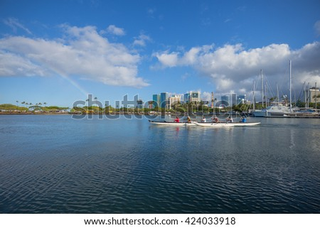 Honolulu, Hawaii, USA, May 21, 2016:  Morning view of an outrigger canoe and crew practicing for the Hawaii State Championship in the Ala Wai Lagoon.